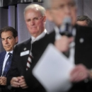 Alabama football coach Nick Saban, rear left, listens to Southeastern Conference Commissioner Mike Slive, right, during a news conference announcing the launching of the SEC Network in partnership with ESPN, Thursday, May 2, 2013, in Atlanta. The network will produce 1,000 live events each year, including 450 televised on the network and 550 distributed digitally. (AP Photo/John Amis)