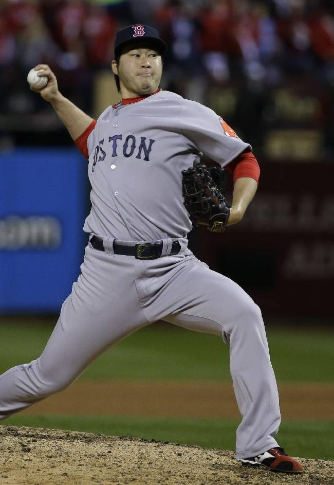 Boston Red Sox relief pitcher Junichi Tazawa throws during the seventh inning of Game 4 of baseball's World Series against the St. Louis Cardinals Sunday, Oct. 27, 2013, in St. Louis
