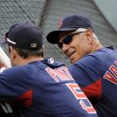 Boston Red Sox manager Bobby Valentine, right, talks with third baseman Nick Punto (5) during batting practice before a baseball game against the Baltimore Orioles, Tuesday, Aug. 14, 2012, in Baltimore. (AP Photo/Nick Wass)