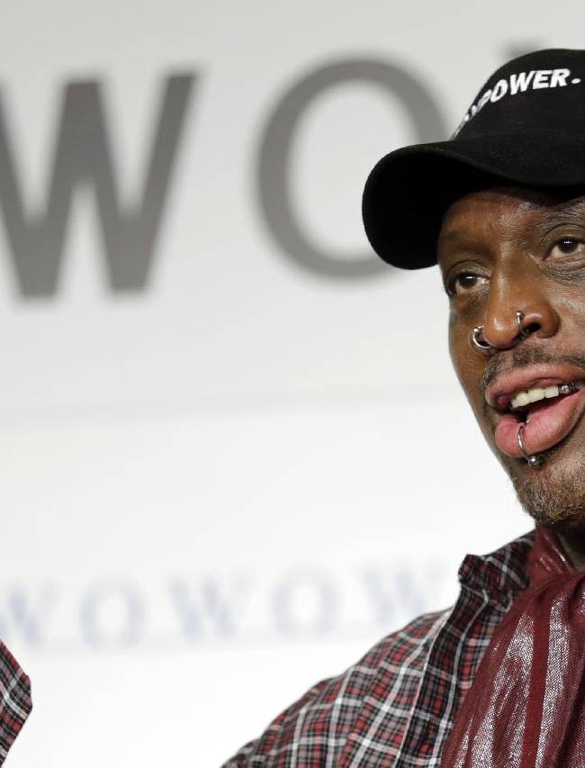 In this Oct. 25, 2013, file photo, former basketball player Dennis Rodman waves during a news conference to promote a Japanese cable network's coverage of the upcoming NBA season, in Tokyo The former Chicago Bulls player's Rodman-themed vodka, that was consumed with friend and North Korean leader Kim Jong Un, is set to debut Thursday, Nov. 21