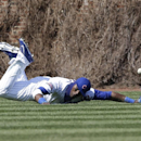 Chicago Cubs left fielder Junior Lake can' t make the catch on a double hit by Cincinnati Reds' Billy Hamilton during the fifth inning of a baseball game in Chicago, Friday, April 18, 2014 The Associated Press