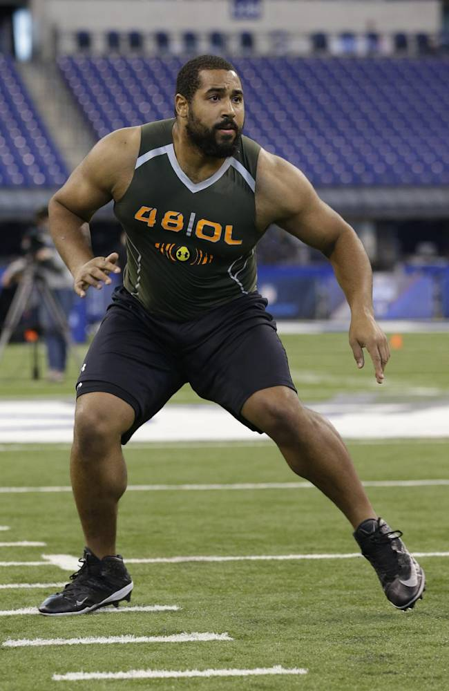In this Feb. 22, 2014 file photo, Penn State offensive lineman John Urschel runs a drill at the NFL football scouting combine in Indianapolis. The most exciting thing about finishing the combine is that I am no longer training like a track athlete. I am once again a football player, and now am focused on doing all I can to ensure that I am prepared for my pro day