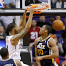 Phoenix Suns forward Markieff Morris dunks on Utah Jazz guard Alec Burks (10) during the second half of an NBA basketball game on Saturday, Nov. 30, 2013, in Phoenix The Associated Press