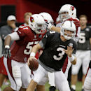 Arizona Cardinals' Carson Palmer (3) tries to scramble away from Alex Okafor (57) during NFL training camp practice Wednesday, Aug. 13, 2014, in Glendale, Ariz The Associated Press