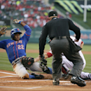 New York Mets' Eric Young Jr., left, is tagged out by Los Angeles Angels catcher Chris Iannetta as he tries to score on a fly ball hit by David Wright during the first inning of a baseball game Saturday, April 12, 2014, in Anaheim, Calif The Associated Pr
