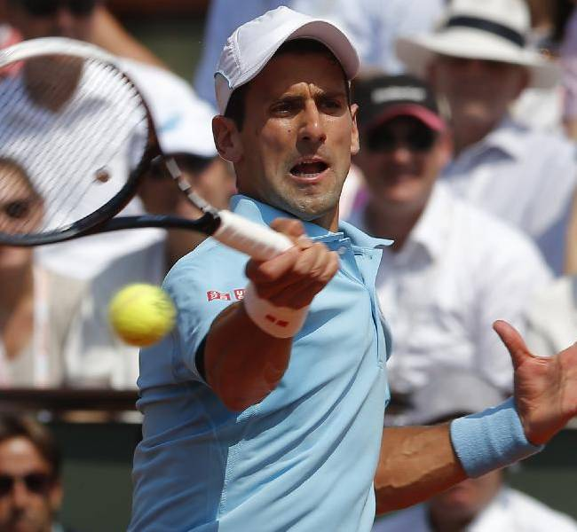 Serbia's Novak Djokovic returns the ball to Spain's Rafael Nadal during the final match of  the French Open tennis tournament at the Roland Garros stadium, in Paris, France, Sunday, June 8, 2014