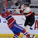 Ottawa Senators forward Chris Neil, right, and Montreal Canadiens defenseman Andrei Markov collide during first period NHL hockey action in Ottawa on Friday, April 3, 2014 The Associated Press