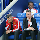 Manchester United manager Louis van Gaal, right, and assistant Ryan Giggs react, during the English Premier League soccer match between Leicester City and Manchester United at King Power Stadium, in Leicester, England, Sunday, Sept. 21, 2014