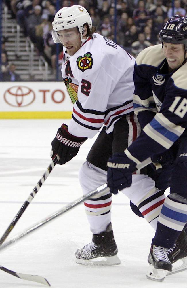 Columbus Blue Jackets' RJ Umberger, right, tries to steal the puck from Chicago Blackhawks' Duncan Keith during the first period of an NHL hockey game on Friday, April 4, 2014, in Columbus, Ohio