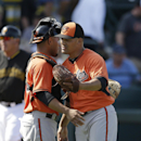Baltimore Orioles catcher Johnny Monell, left, hugs pitcher Eddie Gamboa after their 7-6 win over the Pittsburgh Pirates in a spring exhibition baseball game in Bradenton, Fla., Monday, March 10, 2014 The Associated Press
