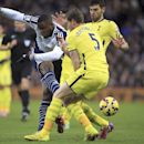 West Bromwich Albion's Victor Anichebe,left, has a shot at goal as Tottenham Hotspur's Jan Vertonghen, foreground, attempts to block during their English Premier League match at The Hawthornes, West Bromich England, Saturday Jan. 31, 2015