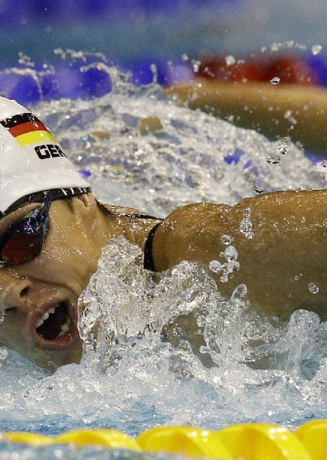 Germany's Franziska Hentke competes in a women's 200m butterfly heat at the LEN Swimming European Championships in Berlin, Germany, Saturday, Aug. 23, 2014