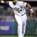 Pittsburgh Pirates third baseman Pedro Alvarez (24) fields a ball and throws to first to get Atlanta Braves' Jason Heyward out to end the first inning of a baseball game in Pittsburgh, Monday, Oct. 1, 2012. (AP Photo/Gene J. Puskar)