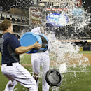 San Diego Padres starting pitcher Andrew Cashner gets doused by Nick Hundley after Cashner threw a one-hitter in the Padres' 6-0 victory over the Detroit Tigers in a baseball game Friday, April 11, 2014, in San Diego The Associated Press