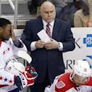 Washington Capitals head coach Barry Trotz, center, stands behind his bench during the first period of an NHL hockey game against the Pittsburgh Penguins in Pittsburgh, Saturday, Dec. 27, 2014. (AP Photo/Gene J. Puskar)
