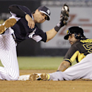 New York Yankees second baseman Brian Roberts balances on one knee as Pittsburgh Pirates Robert Andino looks for the umpire's call after he was caught stealing in the third inning of a spring exhibition baseball game in Tampa, Fla., Friday, March 21, 2014