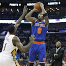 New York Knicks shooting guard J.R. Smith (8) shoots the ball over New Orleans Pelicans point guard Tyreke Evans (1) during the second half of an NBA basketball game in New Orleans, Wednesday, Feb. 19, 2014 The Associated Press