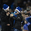 Young soccer supporters applaud before the English Premier League soccer match between Everton and Queens Park Rangers at Goodison Park Stadium, Liverpool, England, Monday Dec. 15, 2014