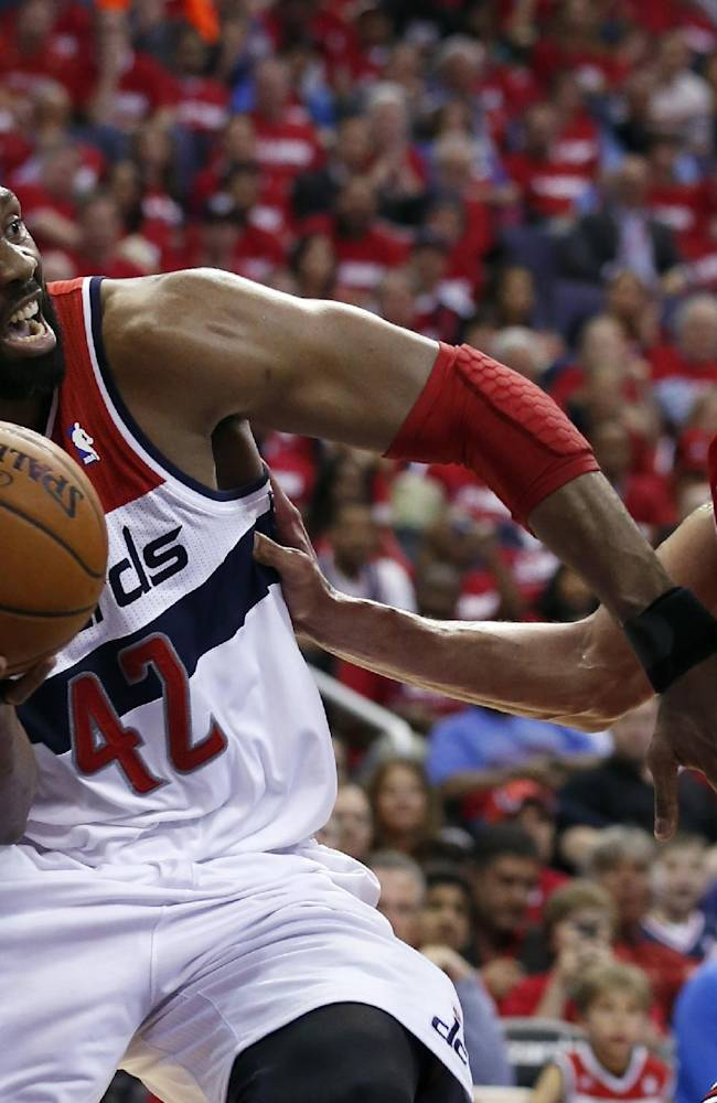 Washington Wizards forward Nene (42), from Brazil, looks to pass as Chicago Bulls center Joakim Noah (13) defends in the second half of Game 3 of an opening-round NBA basketball playoff series, Friday, April 25, 2014, in Washington. The Bulls won 100-97