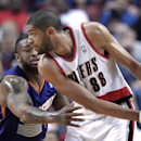 Phoenix Suns forward P.J. Tucker, left, plays tight defense on Portland Trail Blazers forward Nicolas Batum during the first half of an NBA basketball game in Portland, Ore., Friday, April 4, 2014 The Associated Press