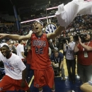 Mississippi guard Marshall Henderson (22) reacts with team mates after the second half of an NCAA college basketball game against the Florida in the final round of the Southeastern Conference tournament, Sunday, March 17, 2013, in Nashville, Tenn. Mississippi won 66-63. (AP Photo/Dave Martin)