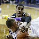 FILE - In this Feb. 8, 2014, file photo, Wichita State forward Darius Carter, top, tries to steal the ball from Northern Iowa forward Seth Tuttle during the second half of an NCAA college basketball game in Cedar Falls, Iowa. The No. 10 Panthers and No. 11 Shockers will play Saturday, Feb. 28, 2015, for the regular-season championship.(AP Photo/Charlie Neibergall, File)