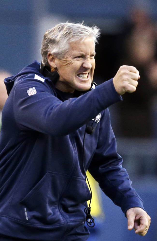 Seattle Seahawks head coach Pete Carroll reacts to the Tampa Bay Buccaneers quarterback being sacked late in overtime in an NFL football game Sunday, Nov. 3, 2013, in Seattle. The Seahawks won 27-24 in overtime