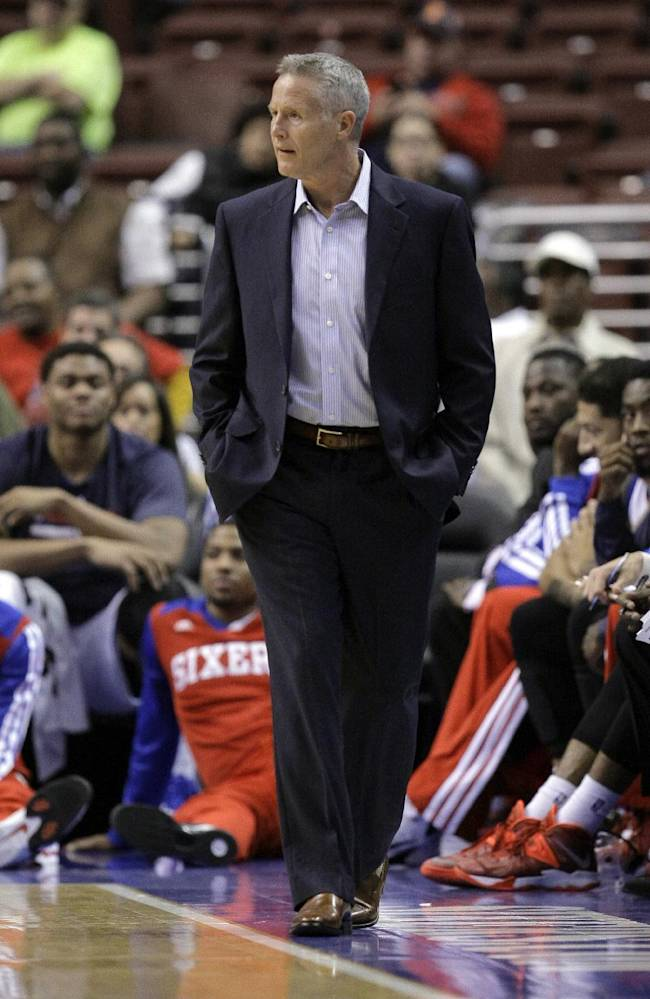 Philadelphia 76ers coach Brett Brown watches from the sidelines during a preseason NBA basketball game against the Minnesota Timberwolves, Wednesday, Oct. 23, 2013, in Philadelphia. Timberwolves won 125-102