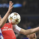 Arsenal's Calum Chambers, center, controls the ball as Anderlecht's Olivier Deschacht, left, and Anderlecht's Youri Tielemans, bottom right, try to intercept the ball during the Group D Champions League match between Anderlecht and Arsenal at Constant Van