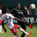 New York Red Bulls defender Ambroise Oyongo (3) and D.C. United forward Eddie Johnson, right, go for the ball during the second half of an MLS soccer match on Sunday, Aug. 31, 2014, in Washington. United won 2-0 The Associated Press