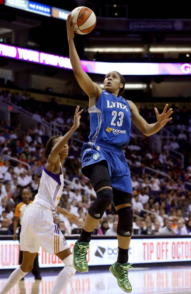Minnesota Lynx's Maya Moore (23) scores as she gets past Phoenix Mercury's DeWanna Bonner, left, during the second half in a WNBA Western Conference Finals basketball game on Sunday, Sept. 29, 2013, in Phoenix. The Lynx defeated the Mercury 72-65 and won the Western Conference Finals 2-0, earning a trip to the WNBA Finals to face the Atlanta Dream