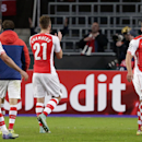 Arsenal's Lukas Podolski, right, turns towards his teammates after the end of the Group D Champions League match between Anderlecht and Arsenal at Constant Vanden Stock Stadium in Brussels, Belgium, Wednesday Oct. 22, 2014. Podoski scored the winning goal