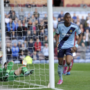 West Ham United's Diafra Sakho celebrates after he scored the opening goal of the game for his side during their English Premier League soccer match against Burnley at Turf Moor, Burnley, Saturday, Oct. 18, 2014