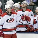 Carolina Hurricanes Eric Staal is congratulated by teammates after scoring on the Toronto Maple Leafs during second period of an NHL hockey game in Toronto, Monday, Jan. 19, 2015 The Associated Press