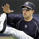 New York Yankees first baseman Mark Teixeira reaches for his leg as he stretches during workouts Friday, Feb. 27, 2015, in Tampa, Fla. (AP Photo/Chris O'Meara)