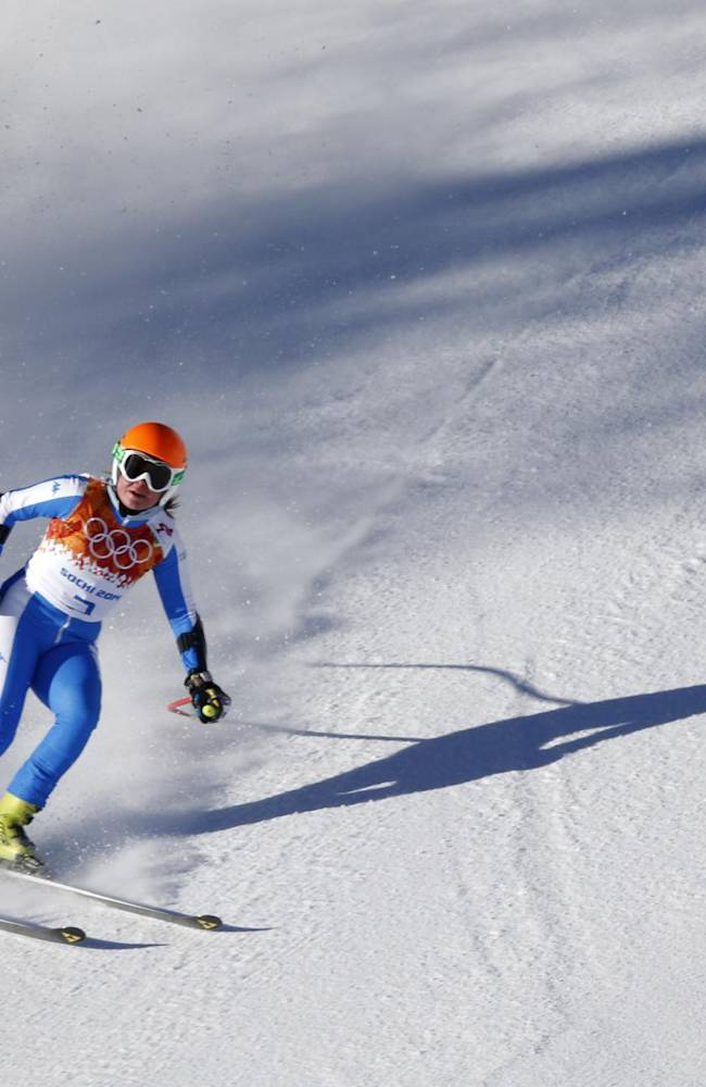 Italy's Verena Stuffer comes to a halt in the finish area after completing a women's downhill training run at the Sochi 2014 Winter Olympics, Thursday, Feb. 6, 2014, in Krasnaya Polyana, Russia