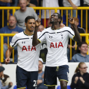 Tottenham Hotspur's Emmanuel Adebayor, right, celebrates his goal against Queens Park Rangers with teammate Nacer Chadli during their English Premier League soccer match at White Hart Lane, London, Sunday, Aug. 24, 2014