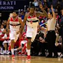 WASHINGTON, DC - DECEMBER 16: Garrett Temple #17 looks on as Rasual Butler #8 of the Washington Wizards celebrates a shot against the Minnesota Timberwolves during the first half at Verizon Center on December 16, 2014 in Washington, DC. (Photo by Rob Carr/Getty Images)