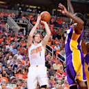 PHOENIX, AZ - OCTOBER 29: Goran Dragic #1 of the Phoenix Suns shoots against the Los Angeles Lakers on October 29, 2014 at U.S. Airways Center in Phoenix, Arizona. (Photo by Barry Gossage/NBAE via Getty Images)