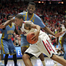 Arizona's Brandon Ashley, front, drives the lane against Southern University's Frank Snow, back,in the first half of an NCAA college basketball game on Thursday, Dec. 19, 2013, in Tucson, Ariz. (AP Photo/John MIller)