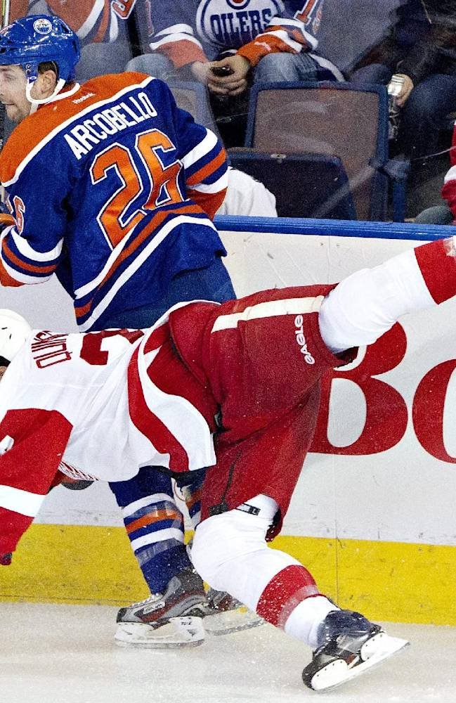 Detroit Red Wings' Kyle Quincey (27) is checked by Edmonton Oilers' Mark Arcobello (26) during the second period of an NHL hockey game in Edmonton, Alberta, on Saturday, Nov. 2, 2013