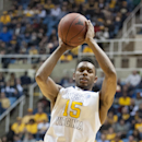 FILE - In this Monday, Feb. 10, 2014, file photo, West Virginia's Terry Henderson (15) looks to pass during an NCAA college basketball game against Iowa State, in Morgantown, W.Va. After two seasons at West Virginia the 6-foot-4 guard sat out last year as a transfer to North Carolina State and has two years of eligibility remaining with the Wolfpack. (AP Photo/Andrew Ferguson, File)