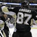 Pittsburgh Penguins' Chris Kunitz, left, celebrates his second-period goal with teammate Sidney Crosby (87), who assisted on the goal, during an NHL hockey game against the Minnesota Wild in Pittsburgh, Thursday, Dec. 19, 2013. (AP Photo/Gene J. Puskar)