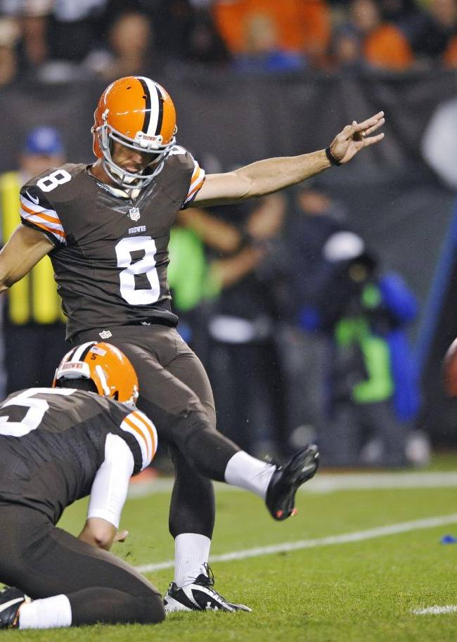 Cleveland Browns' Billy Cundiff (8) kicks a 24-yard field goal against the Buffalo Bills out of the hold of Spencer Lanning in the fourth quarter of an NFL football game Thursday, Oct. 3, 2013, in Cleveland