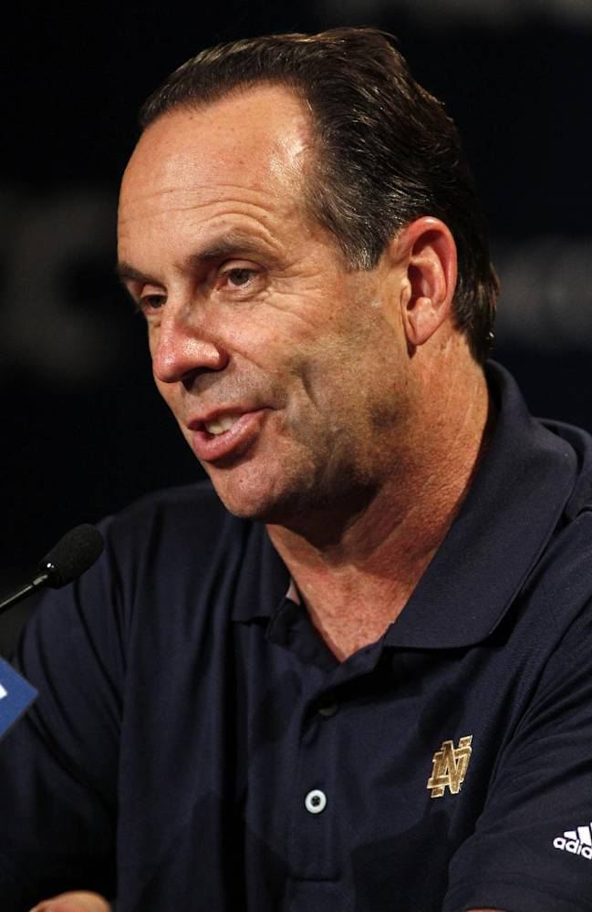 Notre Dame basketball coach Mike Brey answers a question at a news conference during the NCAA college Atlantic Coast Conference media day in Charlotte, N.C., Wednesday, Oct. 16, 2013