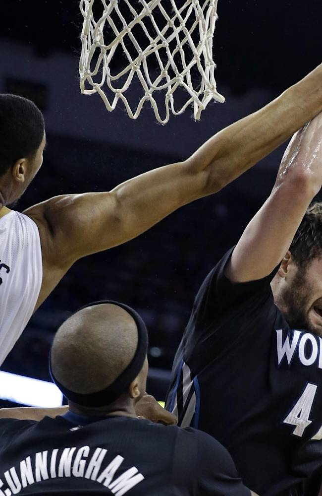 Minnesota Timberwolves power forward Kevin Love (42) pulls in a rebound against New Orleans Pelicans power forward Anthony Davis (23) in the second half of an NBA basketball game in New Orleans, Friday, Feb. 7, 2014. The Pelicans won 98-91