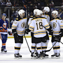 Boston Bruins defenseman Adam McQuaid (54), left wing Milan Lucic (17), ight wing Reilly Smith (18), defenseman Zdeno Chara (33) and center David Krejci (46) celebrates Lucic's goal as New York Islanders center Anders Lee (27) stands in the background du