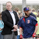 Baseball analyst and former Boston Red Sox pitcher Curt Schilling, left, watches as Dustin Pedroia, right, and other infielders take batting practice at baseball spring training in Fort Myers Fla., Wednesday Feb. 25, 2015. (AP Photo/Tony Gutierrez)