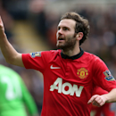 Manchester United's Juan Mata celebrates his goal during their English Premier League soccer match against Newcastle United at St James' Park, Newcastle, England, Saturday, April 5, 2014