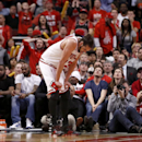 Chicago Bulls center Joakim Noah puts his head down during the overtime period of Game 2 in an opening-round NBA basketball playoff series against the Washington Wizards Tuesday, April 22, 2014, in Chicago. The Wizards won 101-99 The Associated Press